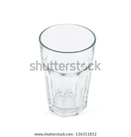 Faceted drinking empty glass cup isolated over white background