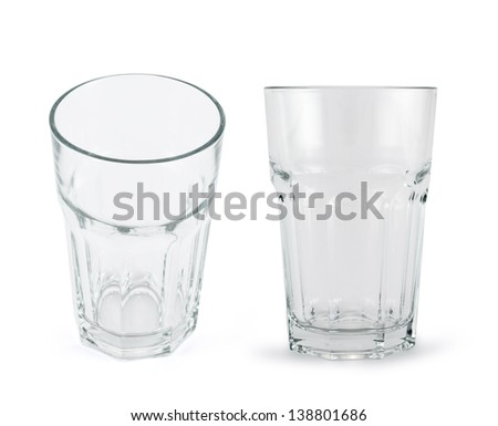 Faceted drinking empty glass cup isolated over white background, set of two