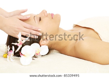 Facial massage at spa salon - stock photo