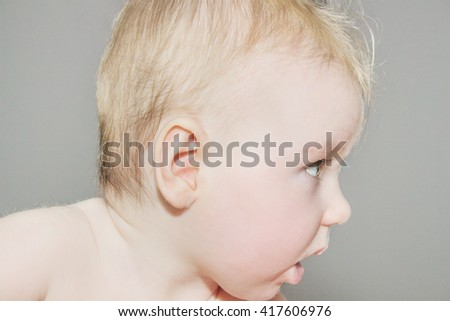 Facial portrait of a museful baby.
