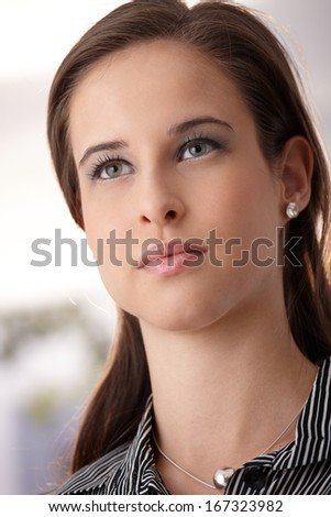 Facial portrait of young beauty, looking determined. - stock photo