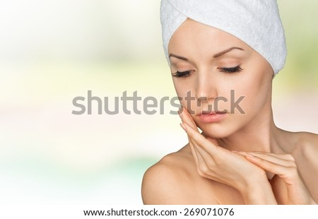 Facial. Spa Girl. Beautiful Young Woman After Bath Touching Her Face. Perfect Skin. Skincare. Young Skin - stock photo