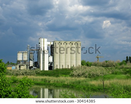 factory and silos on the river