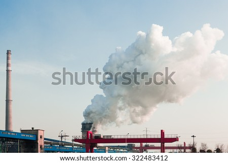 Factory chimney making air pollution - stock photo