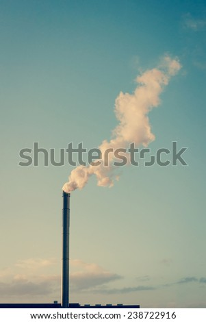 Factory chimney with white smoke - stock photo