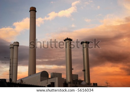 Factory chimneys in the sunset.