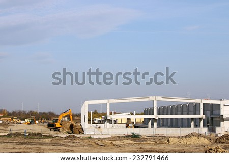 factory construction site with machinery - stock photo