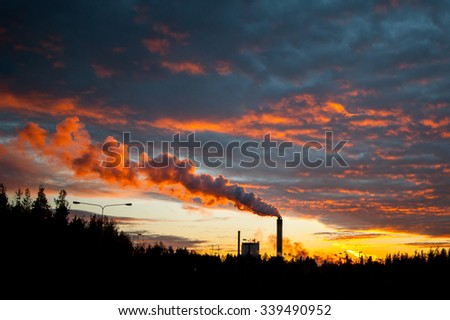 Factory in magical sunset - stock photo