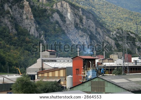factory in the mountain - stock photo