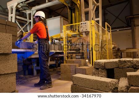 Factory loader at work - stock photo