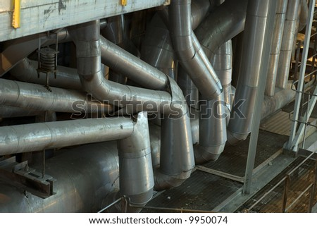Factory machines and piping - stock photo