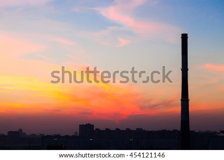 factory pipe in the city at a beautiful sunset, outline