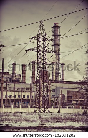 Factory pipes with smoke in the evening - stock photo