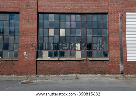 Factory with multicolor window panes  - stock photo