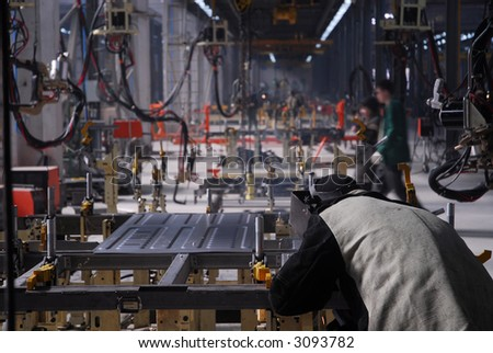 Factory with people and active production 5 - stock photo