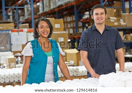 Factory Workers Checking Goods On Production Line - stock photo