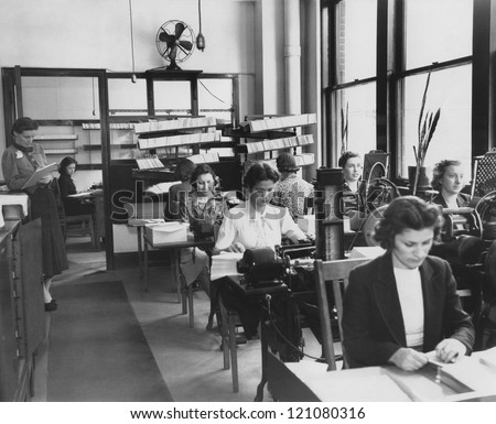 Factory workers on the job - stock photo