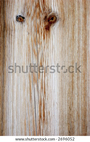 faded cedar cabin panel with two knots like eyes of an owl - stock photo