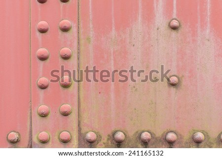 Faded Red Pink Steel metal with water drip erosion, and rivet screw - stock photo