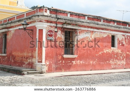 Faded Red Spanish Colonial House in Antigua Guatemala - stock photo