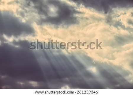 Faded sky with dark clouds and streaming lights. - stock photo