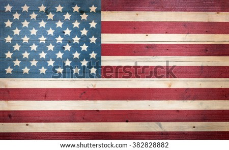Fading wood with USA flag painted on boards.