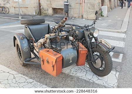 """FAENZA, ITALY - NOVEMBER 2: old sidecar motorcycle BMW R75 750 cc armed with a machine gun, at the military vehicle rally during the festival """"Fiera di San Rocco"""" on November 2, 2014 in Faenza, Italy  - stock photo"""