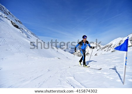 FAGARAS, ROMANIA - MARCH 5: Ski mountaineer competes during the Ski Mountaineering National Competition in Fagaras Mountains, on March 5, 2016 in Romania.