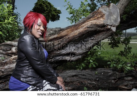 Fahsionable woman in a nature setting - stock photo