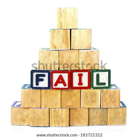 FAIL in alphabet wooden word blocks isolated on a white background                  - stock photo
