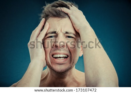 failing man grabbing his head - stock photo