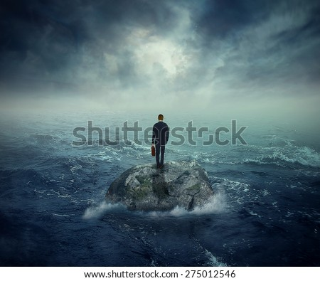Failure crisis concept and lost business career education opportunity. Lonely young man on a rock cliff island surrounded by an ocean storm waves  - stock photo