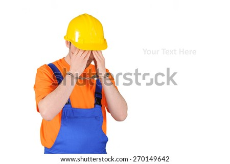 failure guilty laborer regretful criminal handcuffed hard hat blue collar portrait on white background - stock photo