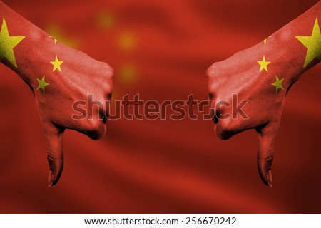 failure of China - hands gesturing thumbs down in front of flag - stock photo