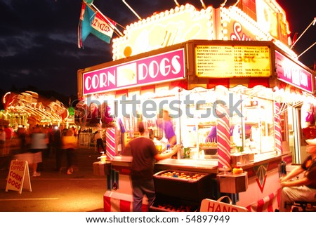 Fair Corn Dogs, part of the midway at the 2009 Douglas County Fair in Roseburg Oregon at night. - stock photo