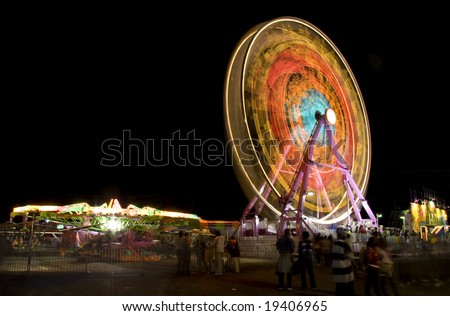Fair rides viewed at night with long shutter speed. - stock photo