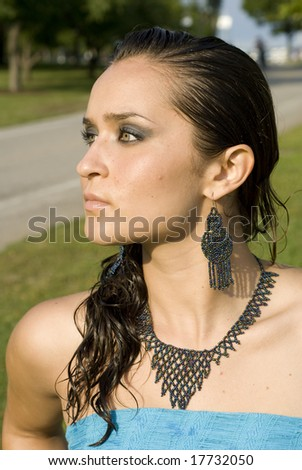 Fair-skinned woman with beautiful black jewelry - stock photo