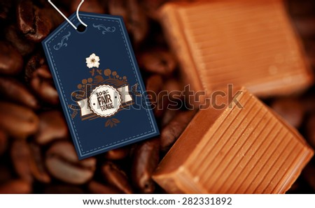 Fair Trade graphic against chocolate pieces and coffee beans side by side - stock photo