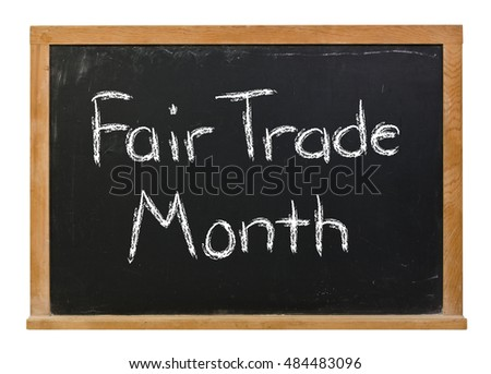 Fair Trade Month written in white chalk on a black chalkboard isolated on white