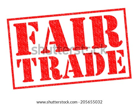 FAIR TRADE red Rubber stamp over a white background. - stock photo