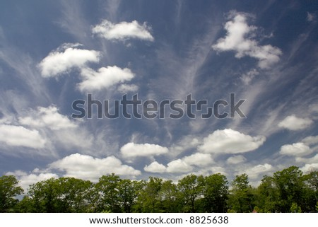 Fair Weather Clouds Blue Skies White clouds cumulus and cirrus cloudscape Editor's Note--In response to comments from reviewer have further processed image to reduce noise and sharpen focus. - stock photo