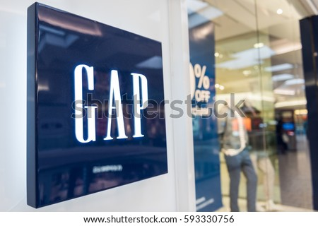 Fairfax, USA - February 18, 2017: Gap storefront with logo by entrance