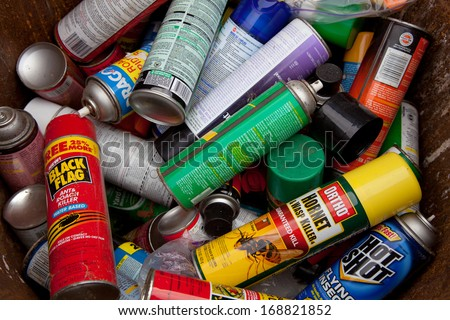 FAIRFAX, VA - DECEMBER 5: A load of bug spray aerosols lying in a heap at a recycling facility on December 5, 2013 in Fairfax, VA. The metal will be separated, processed and melted for recycling. - stock photo