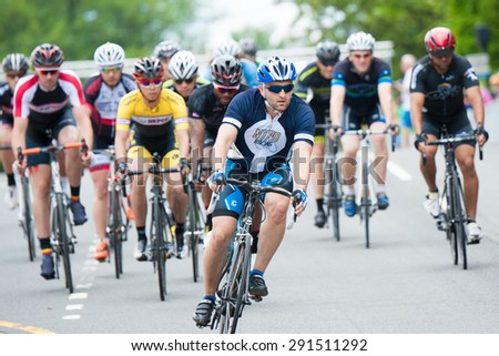 FAIRFAX, VA - JUNE 28: Cyclists compete in the criterium at the World Police & Fire Games on June 28, 2015 - stock photo