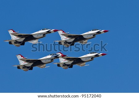 FAIRFIELD, CA - JULY 30: USAF Thunderbirds flying on F-16 Fighting Falcon showing precision of flying during  Airshow  on July 30, 2011 at  Travis Air Force Base, near Fairfield, CA. - stock photo