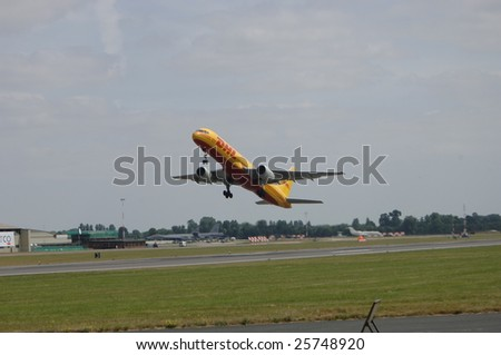 FAIRFORD, UK - JULY 16: DHL Boeing 757 performs  a high alpha take off during an air display at the Royal International Air Tattoo on July 16, 2005 in Fairford, UK.