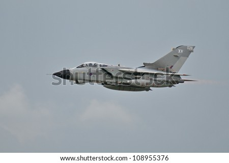 FAIRFORD, UK - JULY 8: Royal Air Force Tornado aircraft participates in the Royal International Air Tattoo airshow event July 8, 2012 near Cirencester, England. - stock photo