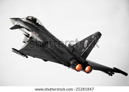 FAIRFORD, UNITED KINGDOM - JULY 14: A Eurofighter demonstrates its abilities at the Royal International Air Tattoo July 14 and 15, 2007 in Fairford. - stock photo