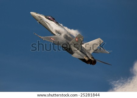 FAIRFORD, UNITED KINGDOM - JULY 14: A Swiss F/A-18 Hornet performs at the Royal International Air Tattoo July 14 and 15, 2007 in Fairford. - stock photo