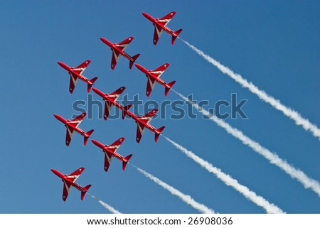 FAIRFORD, UNITED KINGDOM - JULY 15: The RAF aerobatics team Red Arrows perform at the Royal International Air Tattoo July 15 and 16, 2006 in Fairford. - stock photo